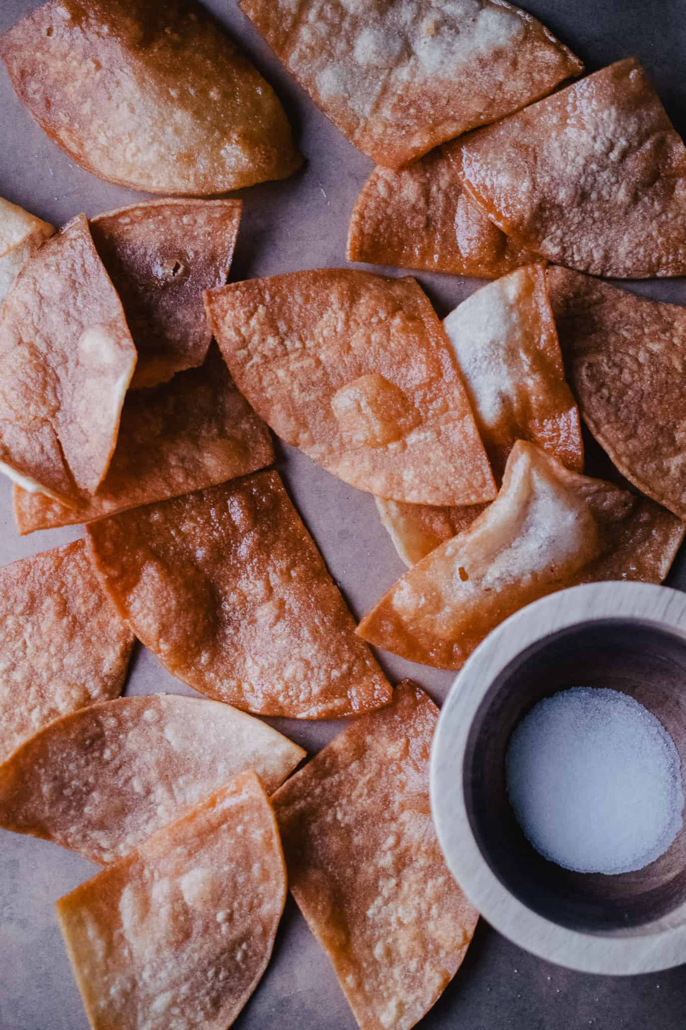 homemade restaurant style warm tortilla chips on brown parchment paper