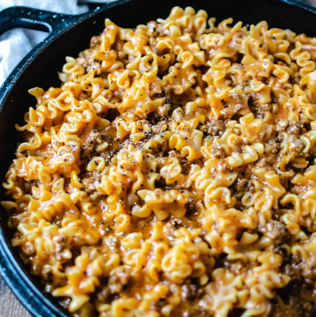 cast iron pan of homemade hamburger helper lasagna
