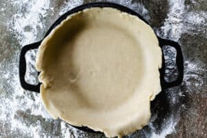 Bottom of pie crust in a pie pan.