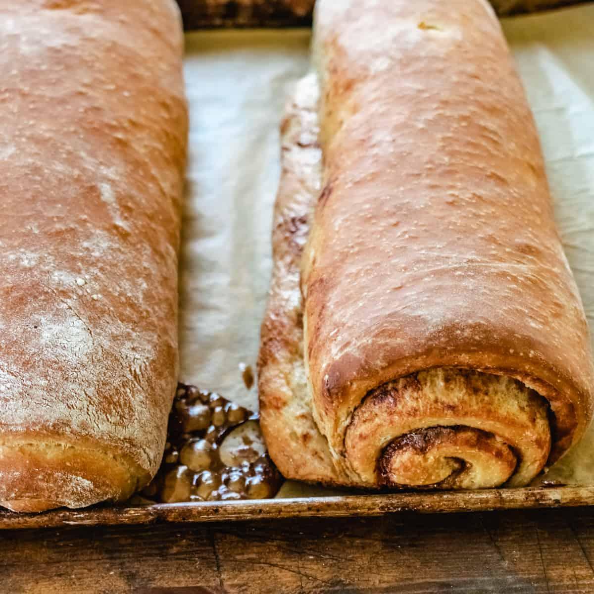 Two loaves of cinnamon bread swirled with cinnamon.