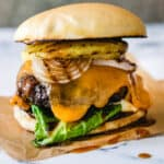beef patty basted in pineapple teriyaki sauce topped with grilled pineapple, lettuce, onion and spicy mayo on a Hawaiian bun