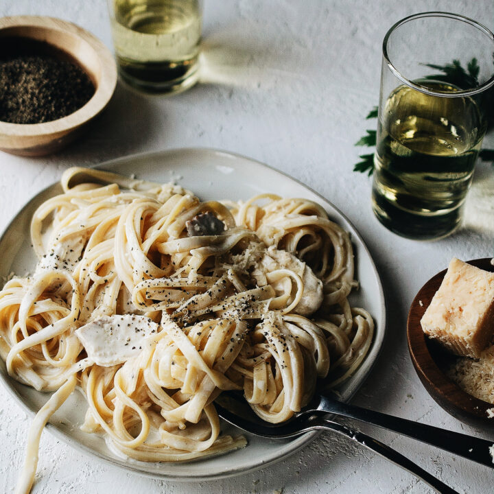 plate of homemade fettuccine alfredo with chicken