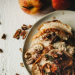 carved roast chicken with apple pecan sauce spooned over