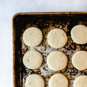 cookie sheet with baked sugar cookies