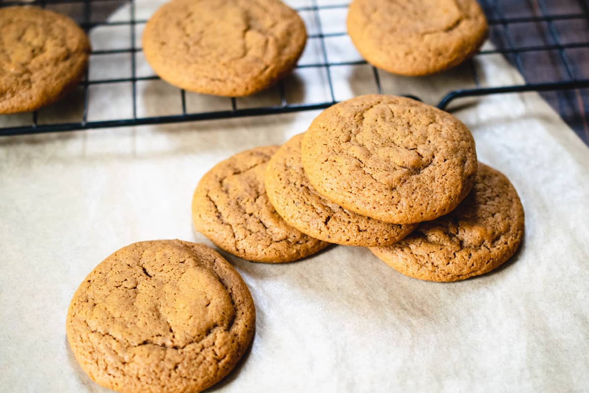 Molasses cookies on a piece of parchment paper.