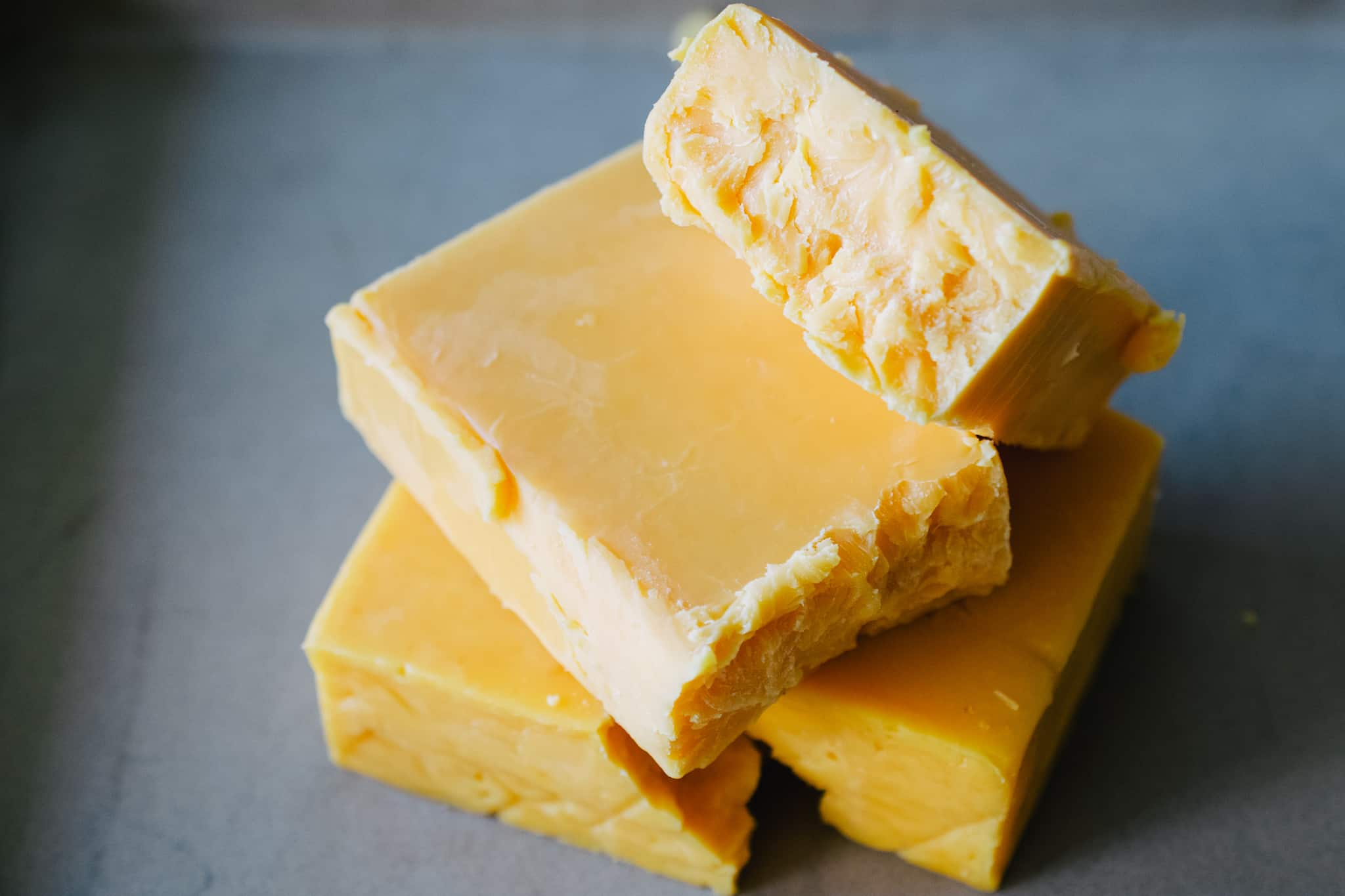 blocks of cheddar cheese