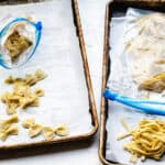 Zip lock plastic freezer bags containing frozen fresh pasta for freezing.