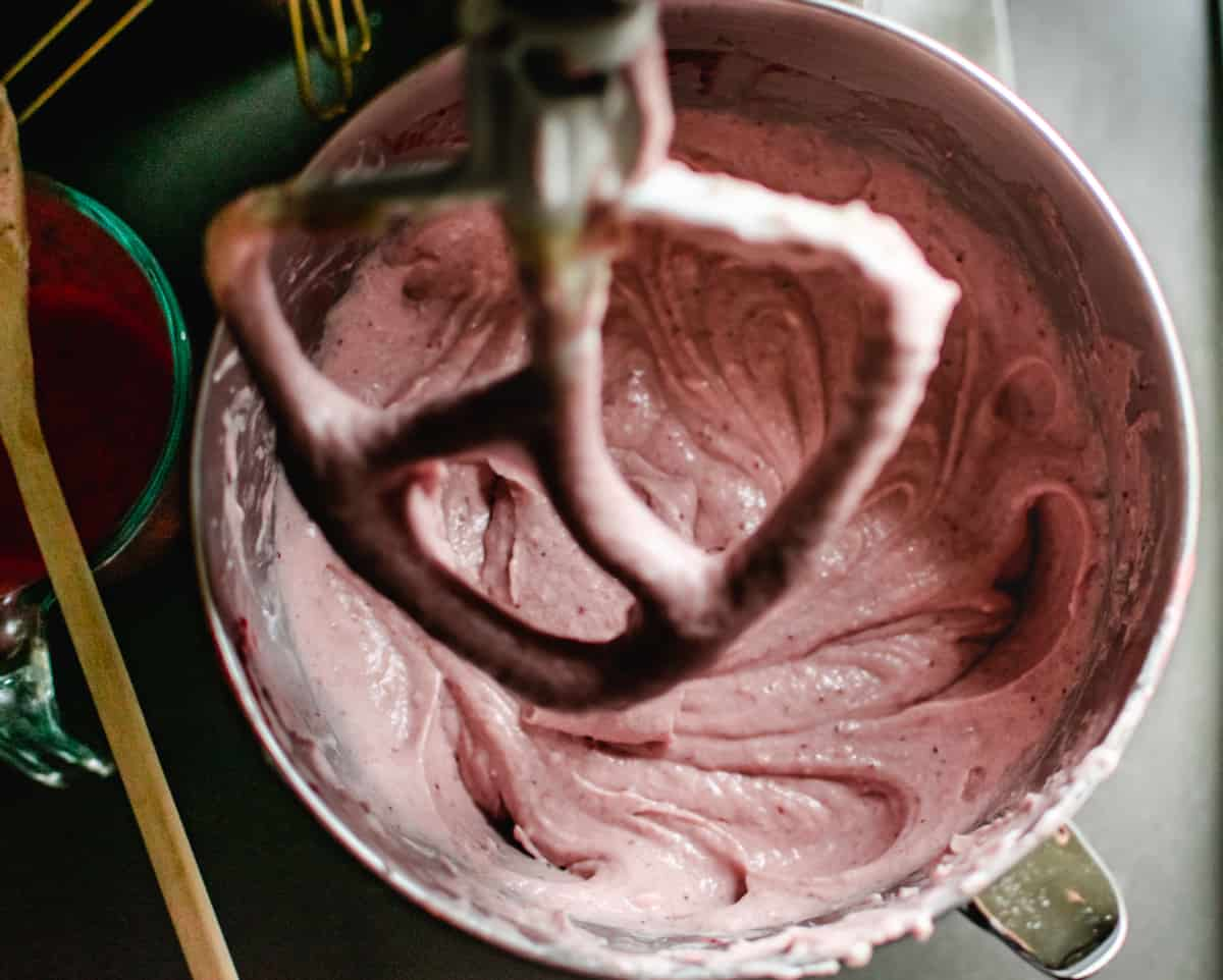 mixing bowl of pink strawberry cake batter