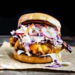 crispy fried chicken sandwich with melted cheese and carrot radish slaw