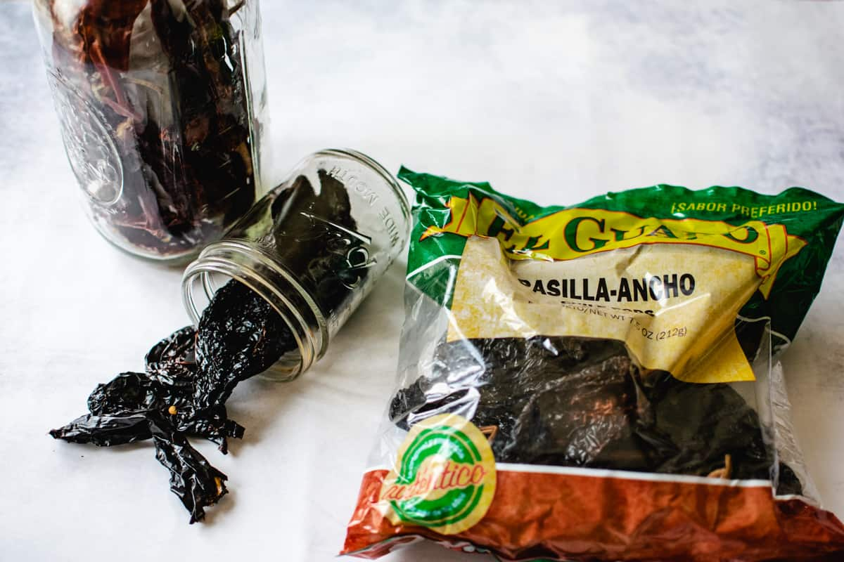bag and jars of dried ancho and guajillo chili peppers