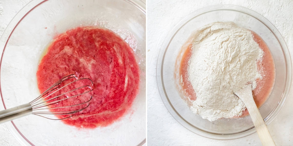 Folding flour and raspberry puree with cupcake ingredients in a bowl.