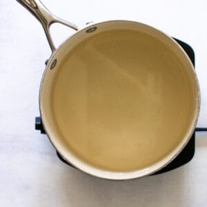 sauce pan filled with brine for pickling radishes