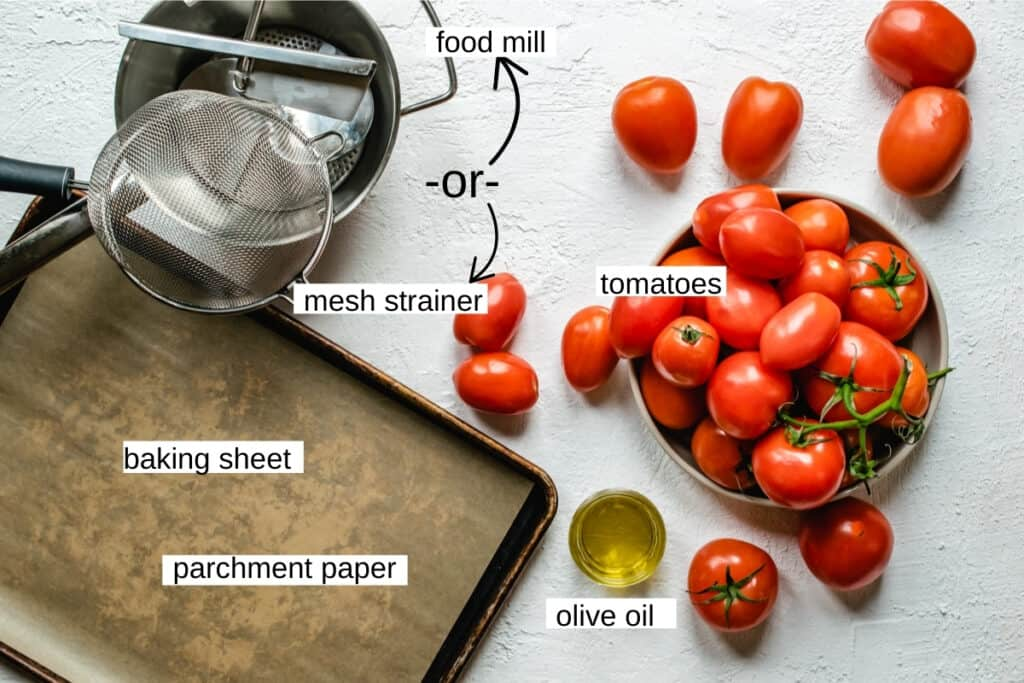 Tomatoes, food mill, baking sheet and olive oil.