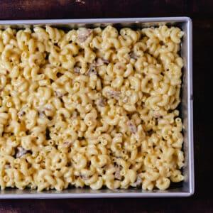 Bacon mac n cheese in a casserole dish.