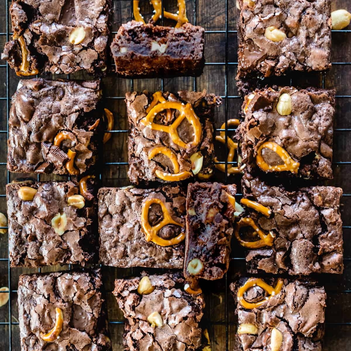 Square cut brownies with nuts, pretzels and chocolate toffee pieces.