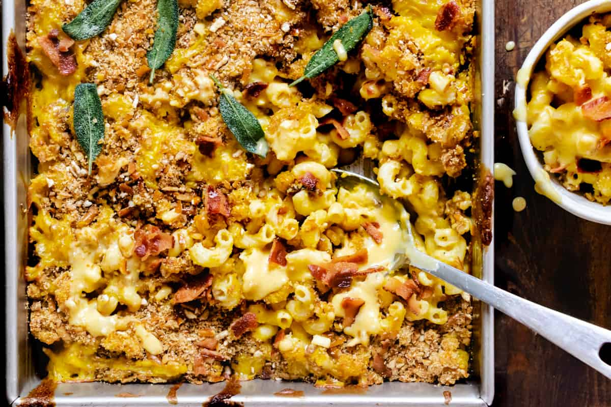 Casserole dish with macaroni, cheese, bacon and herbs.