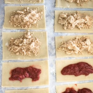 Rectangles of dough being filled with pop tart filling.