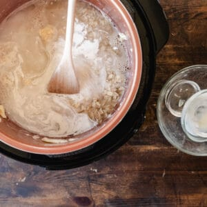 Instant pot filled with uncooked oatmeal ingredients.
