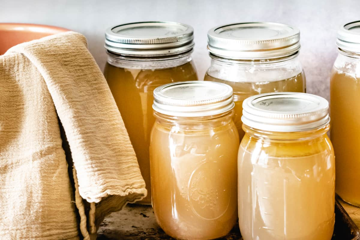 Mason jars with canned chicken and beef stock