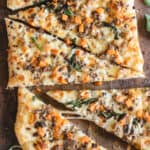 Rustic pizza topped with sausage, sage and sweet potatoes.