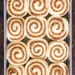 Baking pan of uncooked cinnamon rolls.