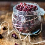 Jar of dehydrated cranberries with jute string tied around it.