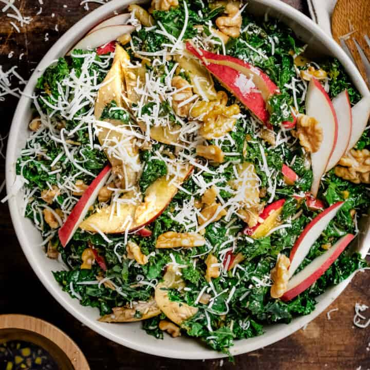 Tossed kale salad with apples and walnuts.