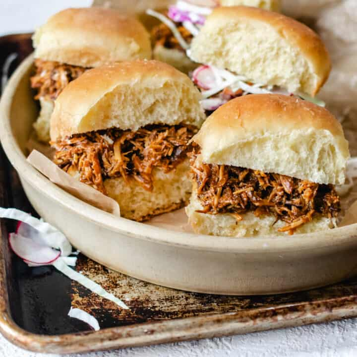 Shredded pork in a barbecue sauce on mini buns with coleslaw on the side.